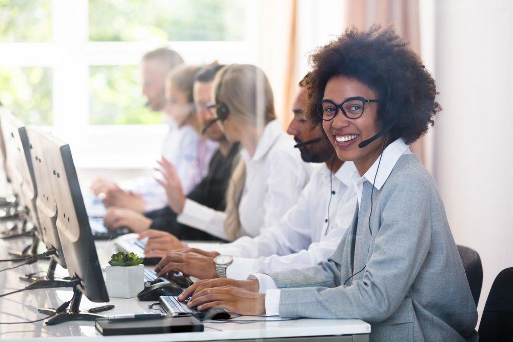 minority woman working in customer service in insurance office